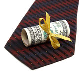 Roll of banknotes and tie. Stock Photography