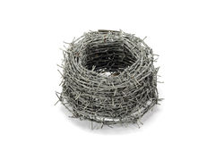 A roll of barbed wire. On white background Royalty Free Stock Image