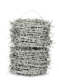 A roll of barbed wire. On white background Royalty Free Stock Photos