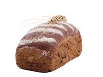 Roll of black bread with wheat ear top on white isolated background Royalty Free Stock Images