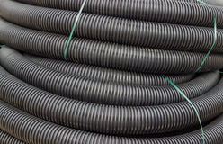 Roll of black flexible conduit nylon pipe background Royalty Free Stock Image