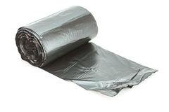 Roll of black garbage bag Stock Images