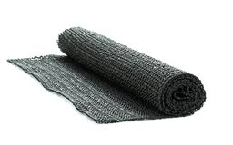A roll of black non-slip rubber matting Royalty Free Stock Photos