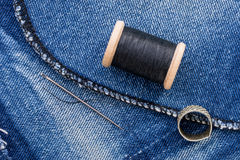 Roll of Black Thread and Jeans Stock Photography