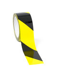 Yellow and black warning tape. Roll of black and yellow caution tape Royalty Free Stock Photo