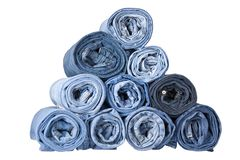 Roll blue denim jeans. Arranged in stack Royalty Free Stock Images