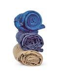 Roll blue denim jeans arranged Stock Photos