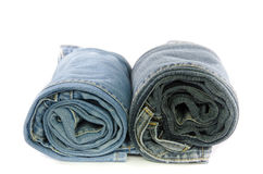 roll blue denim jeans arranged in stack Royalty Free Stock Photos