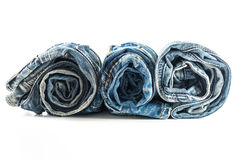 Roll blue jeans isolated Royalty Free Stock Photos