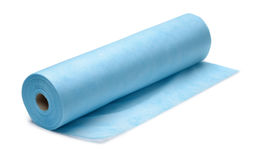 Roll of blue nonwoven fabric. Isolatedon white Stock Images