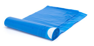 Roll of blue plastic garbage bags isolated on white Royalty Free Stock Photography