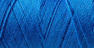 Roll of blue yarn. Stock Photos