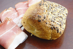 Roll bread and ham. On the table Stock Photography
