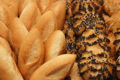 Roll bread with sesame and poppy seeds in a restaurant. Stock Photo