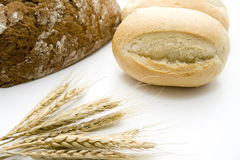 Roll with bread and wheat ears Stock Photos