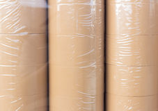 Roll of brown adhesive tape in plastic wrap Royalty Free Stock Images