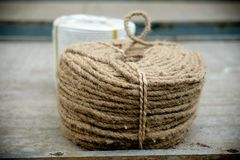Roll of brown rope. On wood table Royalty Free Stock Photo