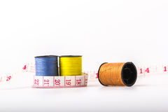 Roll with brown Yellow and blue with a tape measure strapped. Royalty Free Stock Images