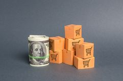 Roll bundle of dollars and cardboard boxes. International trade and trading balance. Global market and business, import and export