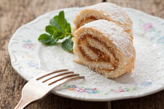Roll Cake. Photo of sweet roll cake on plate with fork Royalty Free Stock Images