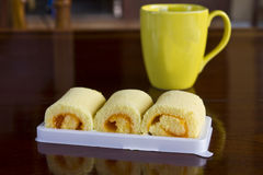 Roll cake and coffee Stock Photography