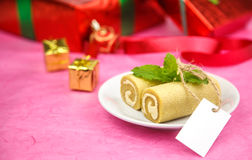 Roll cake on dish with card Royalty Free Stock Image