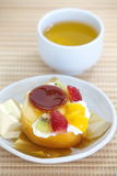 Roll cake and fruits pudding Stock Images
