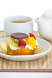 Roll cake and fruits pudding Stock Photography