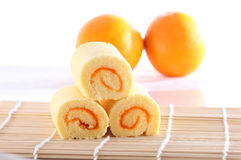 Roll cake and orange Royalty Free Stock Image
