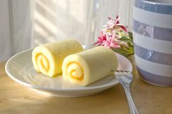 Roll cake on plate Royalty Free Stock Photo