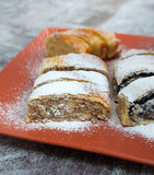 Roll cake with poppy seeds, walnut and cheese Stock Images