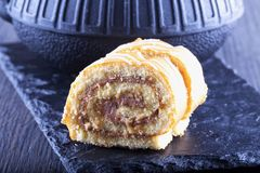 Roll cake with teapot Stock Images