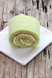 Roll cakes jam flavor pandan leaves on white paper. Stock Photography