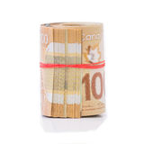Roll of Canadian dollars. Roll of Canadian banknotes wraped with a rubber band Stock Images