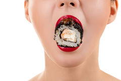 Roll with caviar in mouth woman Royalty Free Stock Images