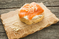 Roll with cheese, lox and horseradish Royalty Free Stock Images