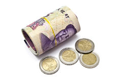 Roll of chinese money and euro coins Stock Image