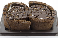Roll chocolate cake isolated on white Royalty Free Stock Image