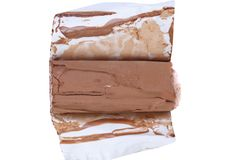 Roll of chocolate ice cream in foil. Royalty Free Stock Photography