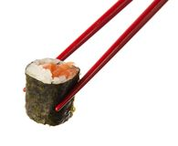 Roll in chopsticks Royalty Free Stock Photos