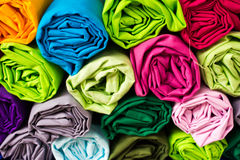 Roll clothes to sort through the mess. Roll clothes to sort through Royalty Free Stock Photo