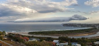 Roll Cloud -Arcus or Roll Cloud over the Pacific near Sydney Australia. A Roll cloud,is a tubular cloud that seems to tumble across the sky. Sinking cold air royalty free stock image