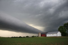 Roll cloud over farm. A eerie roll cloud approaches a small midwestern farm Stock Photos