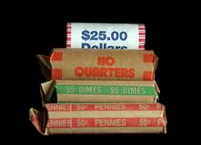 Roll of Coins. A group of rolled coins, dollars, quarters, dimes and pennies Royalty Free Stock Photo
