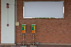 The roll of colorful public phones Stock Photo
