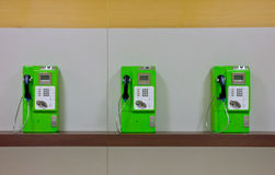 The roll of colorful public phones Stock Photography