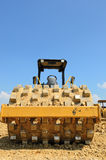 Roll compactor attachment working at site Royalty Free Stock Image