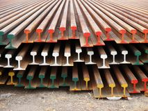 Roll of corroded railway steel beams. On ground Stock Photo