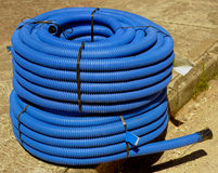Roll of corrugated conduit for microtrench Stock Photography