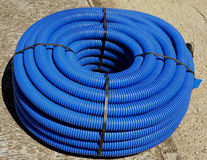 Roll of corrugated conduit Stock Photos